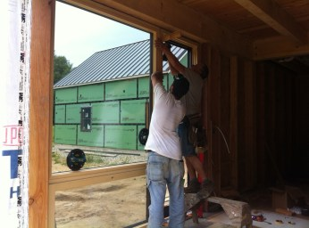 Installing the west-facing living room window unit.