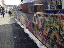 Murals were added to the construction barriers to attract people to the area.