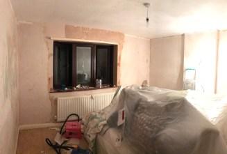 Wallpaper stripping progress in the Master bedroom
