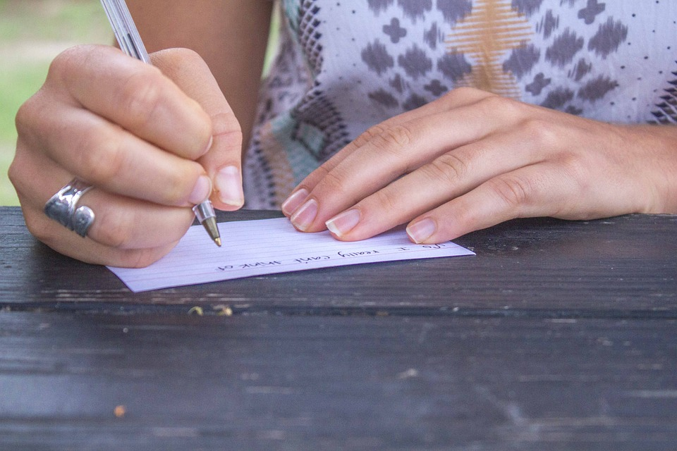 Girl Writing Outside