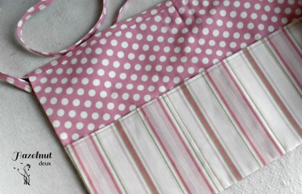 Pink utility apron made with home dec fabric