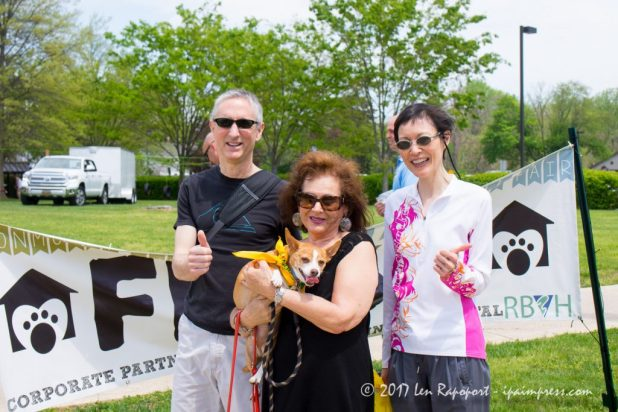 Georgie crosses the finish line at the Monmouth County SPCA Dog Walk with his mom and two friends.