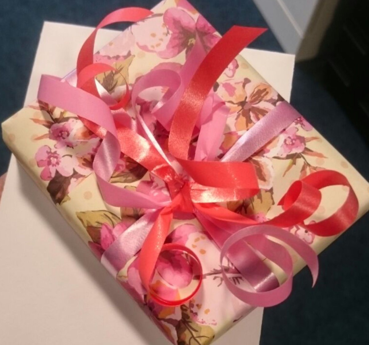 Flowery paper wrapping + pink ribbon