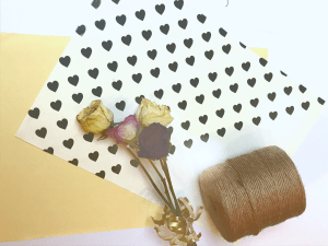 Black heart sticker gift wrapping paper with roll of twine