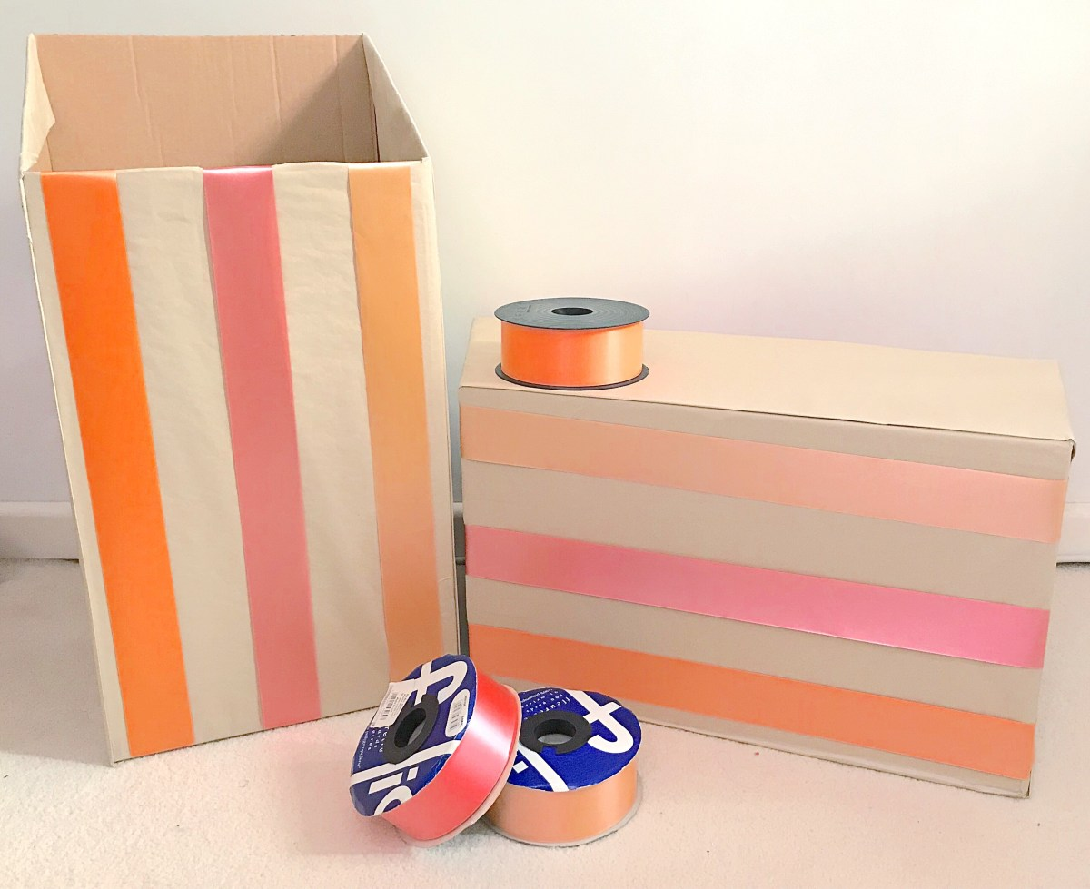Up-cycled gift wrapping storage boxes with ribbons