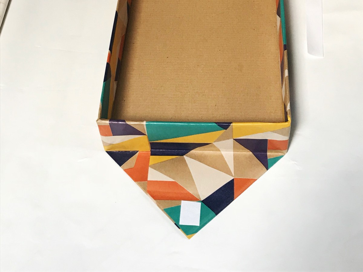 Clarks shoebox before completely covering one end