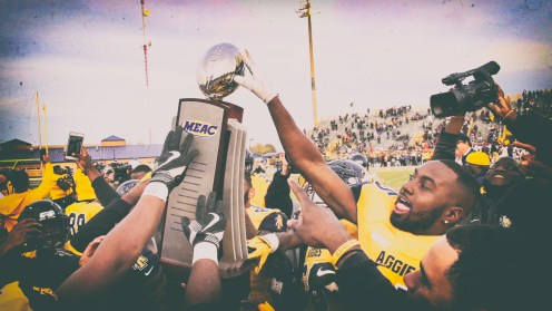 Aggies Gather around the MEAC championship Trophy