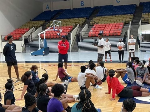 Coach Prime speaks to players at Coach Reed's elite basketball camp