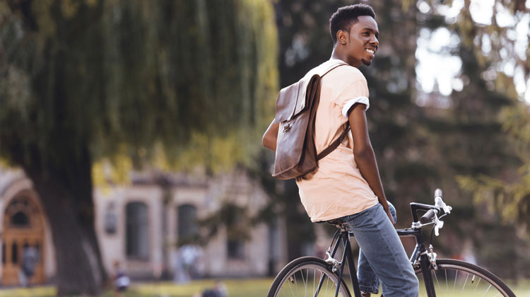 HBCU student sits on his mountain bike on cmapus