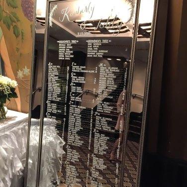 Handwritten wedding table number list on mirrored board at Toronto Wedding