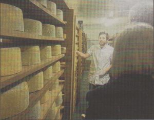 COOL STORAGE: Cheese-maker George bullock showing visitors where the cneese is stored