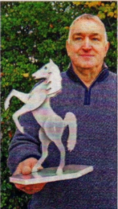 Wingham artist Ian Morrison with a model of the horse