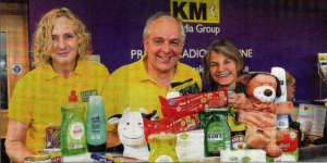 Angela Gardiner, Graham Potts and Fiona Potts with gifts for Canterbury Food Bank, in the Gazette's offices