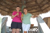 Holly and Sherry at Conch Restaurant tiki hut... celebratory drinks in hand!!