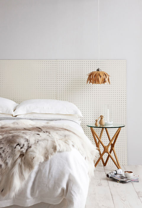 It's not uncommon to see pegboards used in the making of upholstered headboards (here's one tutorial) — but why not just use the pegboard as is? Swedish blogger Sköna Hem proves this look can look totally chic.