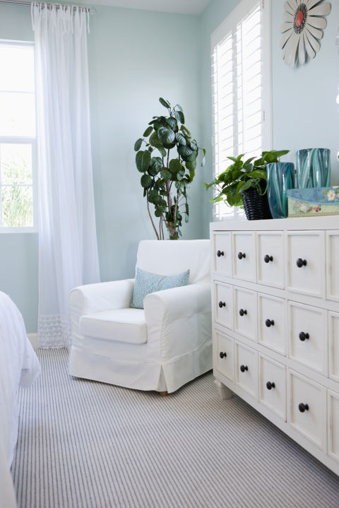 Skip the bright red accent wall and choose colors that have a soothing effect like greens, grays and, especially, blues. A 2013 study from the hotel chain Travelodge found that people who slept in a blue room slept the longest: a dreamy 7 hours and 52 minutes! Ready to DIY? Opt for a paint that has no or low VOCs (volatile organic compounds, which get released into the air and can cause headaches and dizziness).