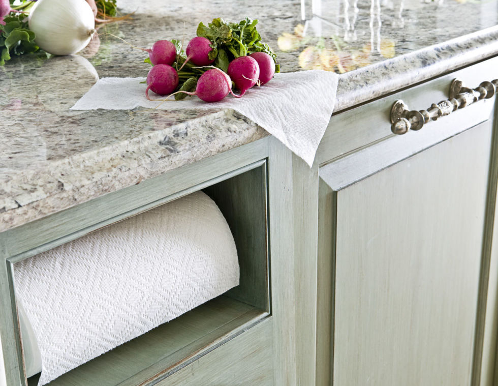 Somehow this niche that keeps paper towels out of sight (but still easily accessible) is so much more chic than when it hangs from your cabinet or sits on your counter.