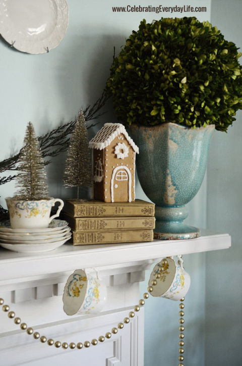 A cute gingerbread house placed on top of vintage books makes for understated festive décor. See more at Celebrating Everyday Life »