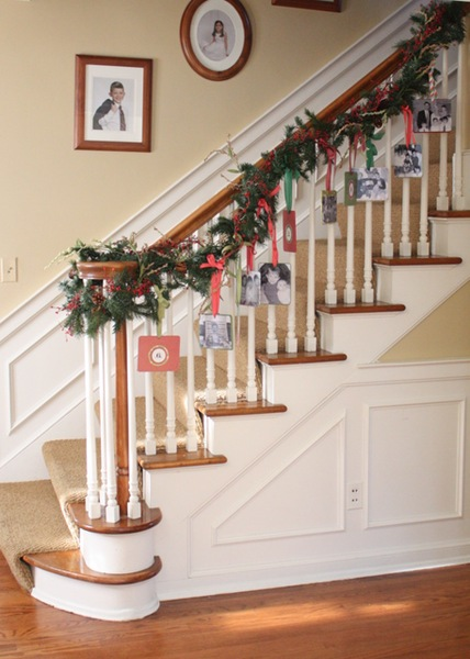 Display family photos and Christmas cards by hanging them for your banister's garland.  See more at Clover Lane »