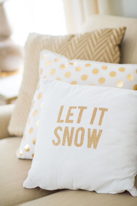 Instead of adding more, change out what you have. One idea: Swap your normal throw pillows for holiday-themed ones, like these DIY pillows from Style Me Pretty. Of course, no need to do it yourself. Feel free to grab your favorite plush holiday pillows — or throws, or bedding — from the store.