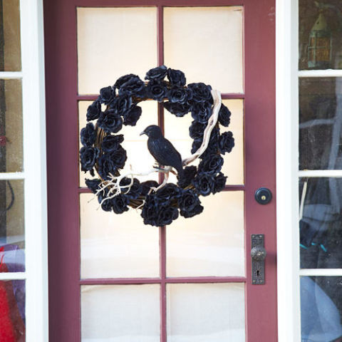 Darken your door with a moldering wreath straight from the crypt. Craft it fast with ebony flowers, a stuffed raven, bone-white branches, and a gnarled grapevine base. See more at Good Housekeeping » What you'll need: black roses($26, amazon.com), crow ($6, amazon.com)