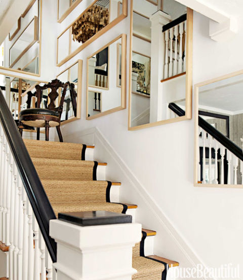 """Mirrors stand in for ancestral portraits in a sly reference to the majestic staircases of 19th-century English country houses. """"It makes my small entry a little bit grand,"""" Tobin says."""