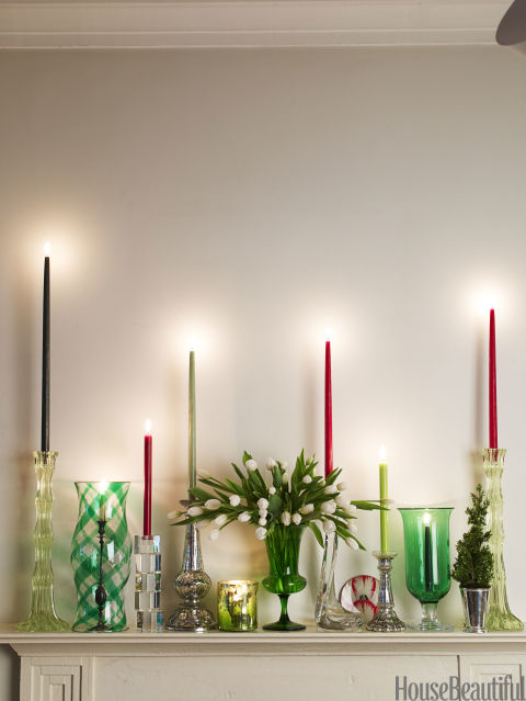 Instead of a garland, a great way to dress a mantel is to fill it with a mix of candlesticks — tall, small, mercury glass, crystal — and put a beautiful vase of flowers in their midst. Everything glitters. And instead of ivory candles, use red, cranberry, shades of green. That gives it another twist. Very festive!
