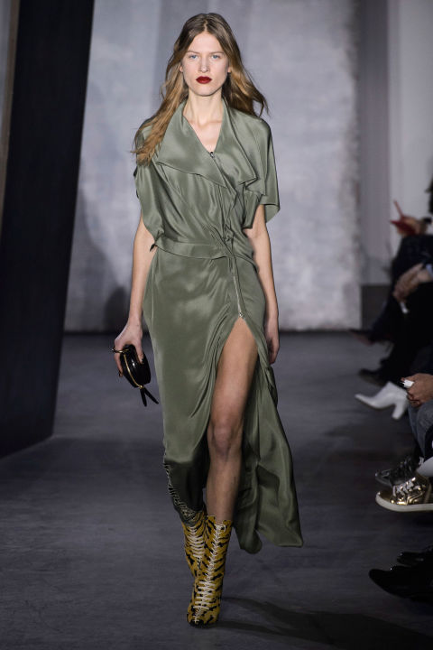 The piece-ier looks and fly-away straps gave way to more pulled-together but tougher-chic styles by show's end. Think Private Benjamin for '15. She'd totally wear a nylon bomber and beaded animal-print pencil skirt.