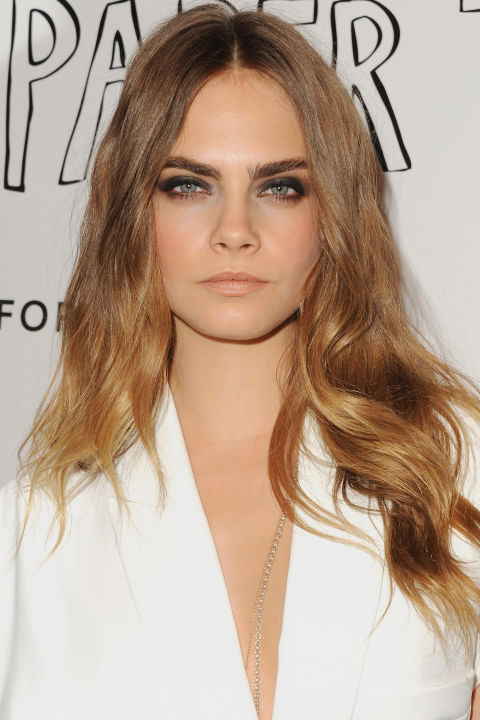 The portmanteau color of summer's midpoint isn't going anywhere come fall. Cara Delevingne blends light brown with caramel and buttery shades in such a way that it'd be impossible to take a hard stance in the brunette versus blonde debate.