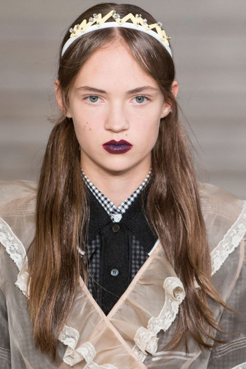 The Look: Goth Princess How-To: Expect the unexpected, the quirky, the youthful—that's the motto at Miu Miu. Others wouldn't be able to make pigtails and a sparkly crown look anything but adorable; Miuccia Prada gives the headpiece jagged geometric detailing and leaves the screws exposed, then tops the look off with a moody plum lip stain, and suddenly it's spooky.