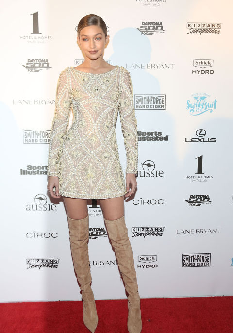 For Sports Illustrated's VIP BBQ in Miami, Hadid sparkled in a champagne-colored Herve Leger mini dress teamed with thigh-high suede boots.