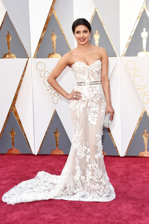 """Priyanka Chopra stunned in an intricately embroidered mermaid silhouette by Zuhair Murad with an illusion skirt at the 88th Annual Academy Awards. Get the Look: Zuhair Murad """"Petra"""" bridal gown, $14,405, Mark Ingram Atelier, 212.319.6778."""
