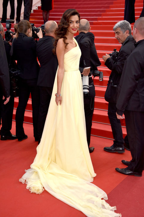 Amal Clooney donned a canary yellow draped silk chiffon gown by Atelier Versace to a screening of Money Monster on the second day of the 69th Annual Cannes Film Festival. Take notes: a subtle hue and an artfully draped silhouette are the quick and easy way to appear elegant and effortless.
