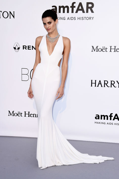 """Isabeli Fontana turned heads on the carpet at amfAR's 23rd Cinema Against AIDS Gala at the Cannes Film Festival, accenting her uber-minimalist fishtail gown with a jaw-dropping diamond collar.  Get the Look: Vera Wang Bride """"Priscilla"""" sheath, price upon request, verawang.com."""