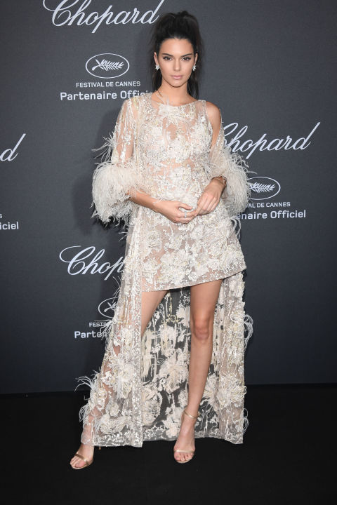 """Kendall Jenner ruled the night at the Chopard Wild Party in Cannes in an Elie Saab Haute Couture embellished mini dress paired with a matching feather-trimmed duster coat, Chopard jewels and Jimmy Choo stilettos. For the aisle, wedding day separates that give the illusion of a gown at the altar but free your legs up with a shorter length for dancing are the best of both worlds. Get the look: Naeem Khan """"Bolivar"""" ensemble, price upon request, naeemkhan.com"""