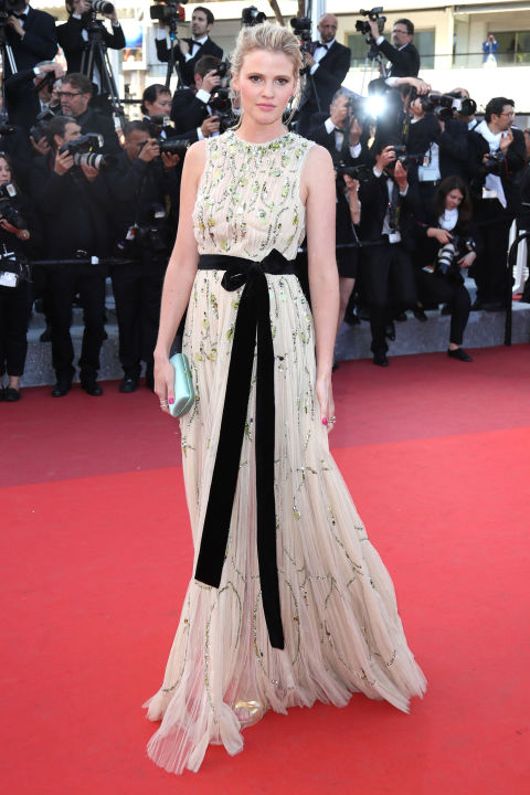 Lara Stone walked the Cannes red carpet for the premiere of Julieta in an embroidered buff-colored Prada tulle sheath accented with a black belt and styled with Repossi jewels. Not about wearing alabaster down the aisle and think pink is too prim? Nude silk tulle (preferably with some added sparkle) and black accents are your new best friend.
