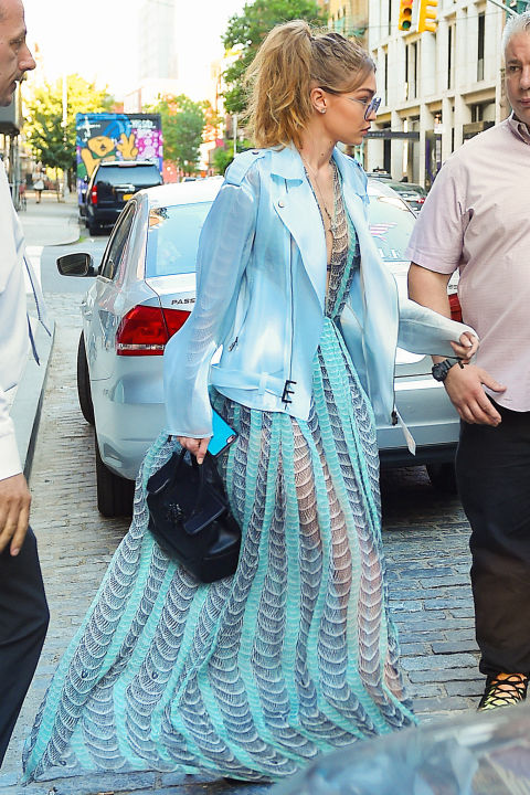 Heading to JFK airport to catch a flight to Toronto, where she's hosting the Much Music Video Awards, in a sheer blue gown and moto-style jacket.