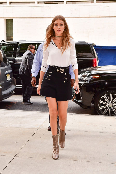 Keeping up with the nautical theme of her Tommy Hilfiger collab, Hadid wears a sailor-esque blouse,belted high-waisted shorts with button details, metallic boots and a choker to her Tommy x Gigi press conference in NYC.