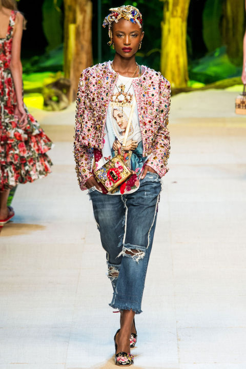 Another familiar Dolce & Gabbana trope is religious iconography, seen here as images of saints printed on t-shirts, gauzy blouses, A-line skirts, boleros and pajama suits. The team also sent out denim, which had to be Gabbana-fied with fringe tassels, heavy embroidery and sequins. If ever denim was ok for evening cocktails, you could consider these jeans.