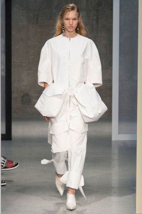 Consuelo Castiglione was obsessed with architectural abstracts for Marni's spring collection. Also, the fanny pack, which she blew up to oversized proportions and doubled up. It was hands-free dressing on overdrive (except when the width knocks everything down in its path)...