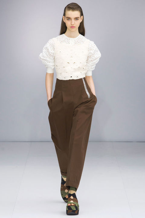 Another interesting note were the layers of lace, seen on white shirts under bibs, fluted skirts and trimming ribbed dresses. It was delicate yet offered a graphic counter to the straightforward tonality of the rest of the collection.