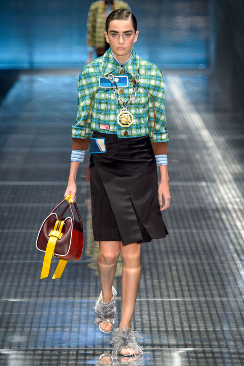 """Geeks and chics—this is Miuccia Prada's special talent. She is the queen of ugly fashion, where """"ugly"""" is the highest kind of compliment because it's unexpected, challenging and at its very root, something a lot of women want, whether they are minimal or maximal, high-loving or low-, esoteric or just in it because it's delightful fun to look at. Spring brought all these contrasts together in a wonderful, weird, exciting collection that was backed by a trippy original film byAmerican HustleandJoydirectorDavid O. Russell, starring Freida Pinto."""