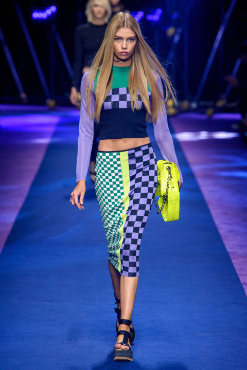Versace came up with alluring ways to push sport, from parachute material transformed into color blocked jogger pants and jackets and, less more unexpectedly, as saucy ruched dresses with thigh-high slits. Elsewhere car racing checks and colors took on cooler proportions when re-imagined as little leather jacket-and-mini combos or a cropped sweater and pencil skirt.