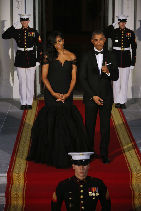 Quite possible one of the First Lady's most iconic looks, the President couldn't help but give his wife a thumbs up for this stunning black Vera Wang gown.