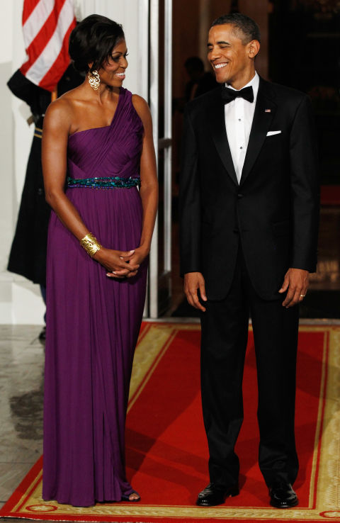 Michelle Obama wears a beautiful purple gown with turquoise beaded waist by Korean-American designer Doo-Ri Chung.