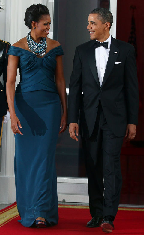 While Michelle Obama's navy, off-the-shoulder Marchesa gown is lovely, her statement necklace by Tom Binns definitely stole the show.