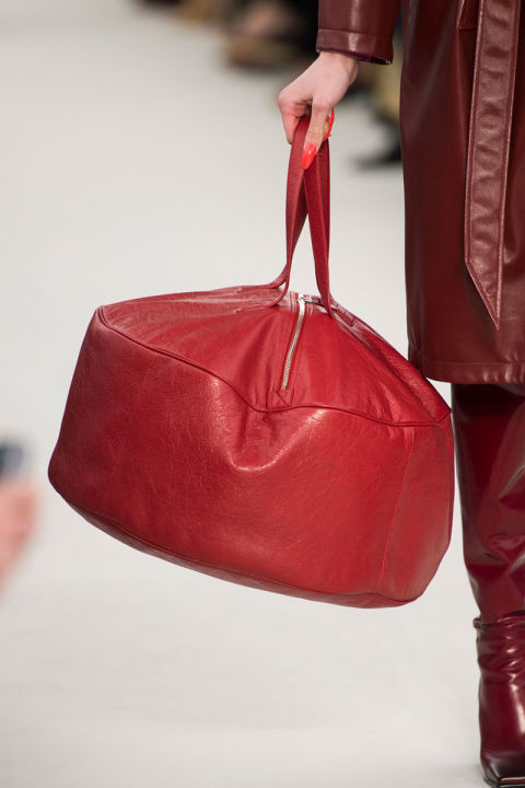On the other side of that curious Alice equation are extra largehandbags—from Moroccan poufs at Balenciaga to giant totes at Celine and lady bags gone large at Marc Jacobs—you can never havetoo much of a good thing. Pictured: Balenciaga