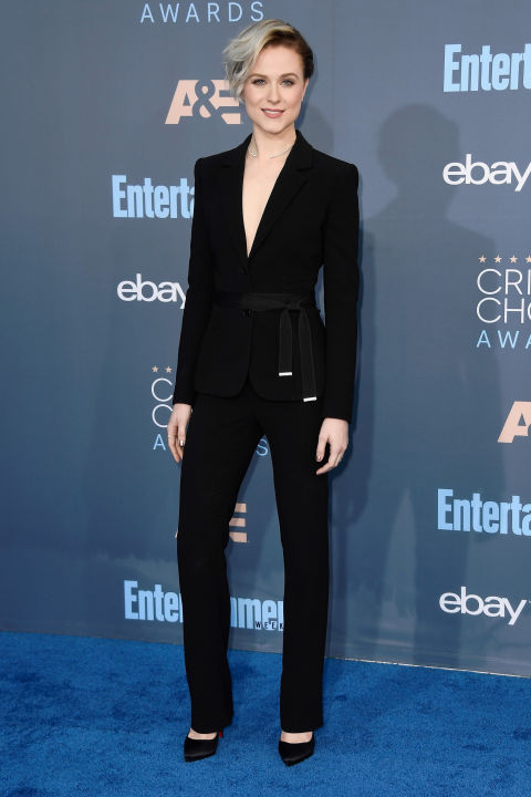 In Altuzarra suit, Anita Ko jewelry, and Christian Louboutin heels.