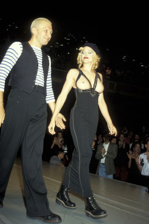 """Back in 1992, Madonna made her catwalk debut for Jean Paul Gaultier at his amFAR extravaganza wearing nothing but a tube dress and the frame of the bra. """"I was supposed to wear a top and jacket like Jean Paul's, but at the last minute I decided it was better to go out topless,"""" she said on the night."""