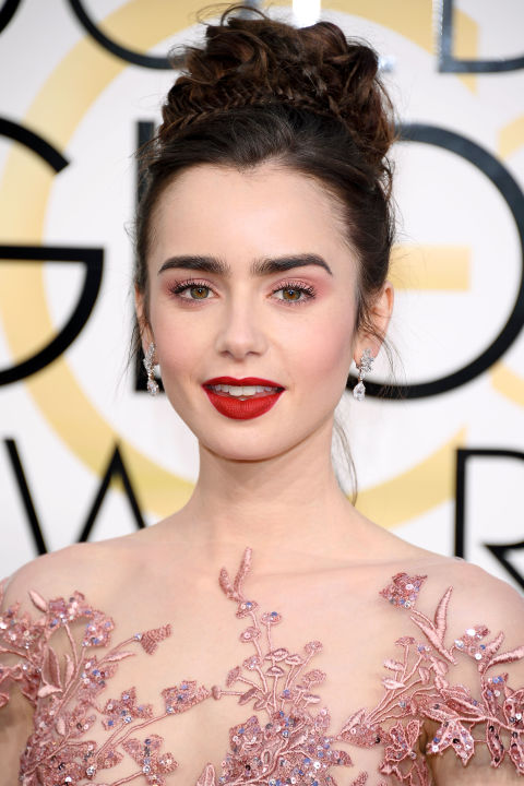Nominated for her work in Rules Don't Apply, actress Lily Collins proves that there is no better beauty combination than pink and red (her lipstick, by the way, is Lancôme L'Absolu Rouge in Souvenir). Collins' hairstylist Gregory Russell upped the princess-factor by creating a dramatic updo sprinkled with braids.
